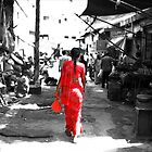 Red  Sari. Delhi. India by EUNAN SWEENEY