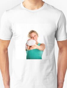 Young woman holds a pebble with BEACH written on it  Unisex T-Shirt