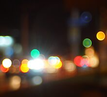 Abstract blurred image of lights and flare from the headlights of cars by vladromensky