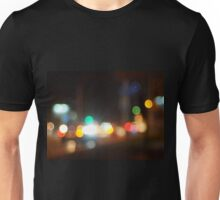 Abstract blurred image of lights and flare from the headlights of cars Unisex T-Shirt