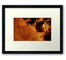 Bauble on the wall Framed Print