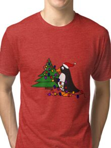 Funny Cool Penguin Putting Christmas Lights on Tree Tri-blend T-Shirt