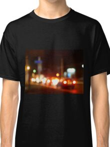 Trucks and cars with headlights was blurred for use as a background Classic T-Shirt
