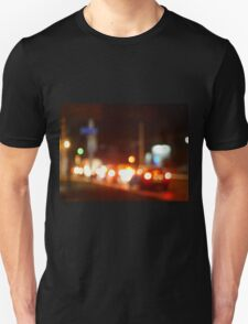 Trucks and cars with headlights was blurred for use as a background Unisex T-Shirt