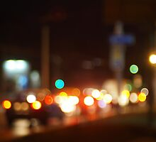 Defocused image of traffic on night city street by vladromensky