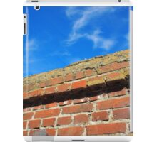 Upper part of the stone wall of bricks against a bright blue sky iPad Case/Skin