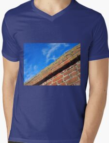 Bottom view on top of the stone wall of bricks against a blue sky Mens V-Neck T-Shirt