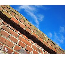 Bottom view on a fragment of an old brick fence Photographic Print