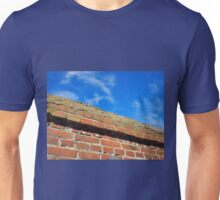 Bottom view on a fragment of red brick fence Unisex T-Shirt