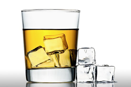 glass of whisky on the rocks by Gert Lavsen