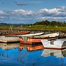 Boats in natural harbor by Gert Lavsen