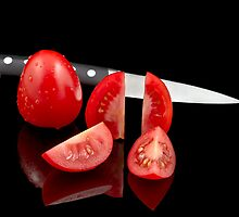 Fresh tomatoes and knife by Gert Lavsen