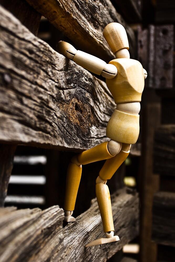 Wooden Man Climbing Bran 01 by cadman101