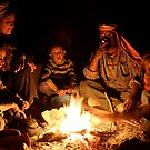 Bedouin family around the fire by George Woodcock
