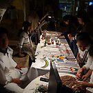 Huichol selling artcraft at night - Huichol venden artesania en la noche by Bernhard Matejka