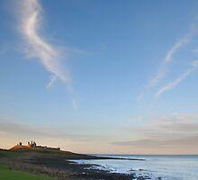 Towards Dunstanburgh castle at dusk by StephenRB