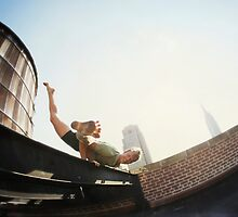 Addam Ringer, Yoga on a roftop in New York by Wari Om  Yoga Photography