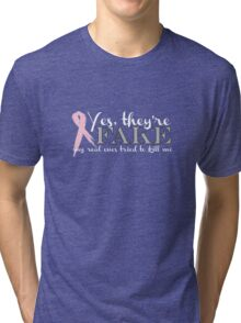 Yes, they're FAKE  My real ones tried to kill me Tri-blend T-Shirt