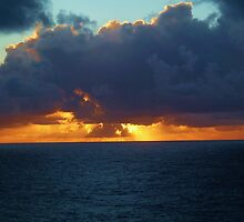 Caribbean sunset at sea by eyeland