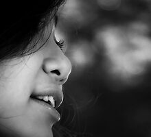 Black and white closeup of the face of a smiling  by Nhan Ngo