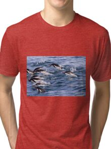 Gentoo penguins (Pygoscelis papua). swimming in the ocean Tri-blend T-Shirt