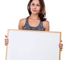female bodybuilder holds a blank whiteboard ready for your own message Model release available  by PhotoStock-Isra