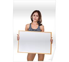 female bodybuilder holds a blank whiteboard ready for your own message Model release available  Poster