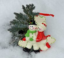 Cute couple with Santa costumes kissing and hugging on Christmas  by Anton Oparin