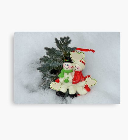 Cute couple with Santa costumes kissing and hugging on Christmas  Canvas Print