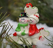 Cute couple with Santa costumes kissing and hugging on Christmas 2 by Anton Oparin
