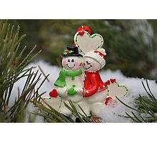 Cute couple with Santa costumes kissing and hugging on Christmas 2 Photographic Print