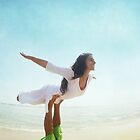 Acroyoga flying in the beach by Wari Om  Yoga Photography