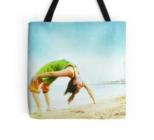 Full wheel with one hand in the beach Tote Bag