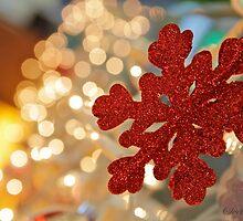Red snowflake and Christmas lights  by Svetlana Day