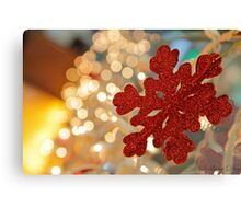 Red snowflake and Christmas lights  Canvas Print