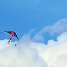 Rainbow colored kite in the clouds by Svetlana Day
