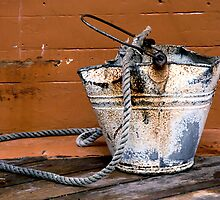 rusty bucket by sandymayasphoto