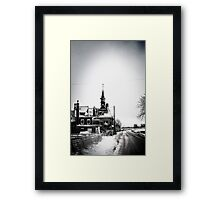 A battered church on a winter's road Framed Print