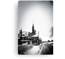 A battered church on a winter's road Canvas Print