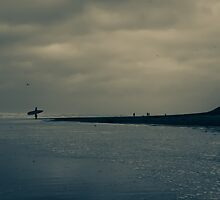 Surfer on Winter Beach by Remco den Hollander