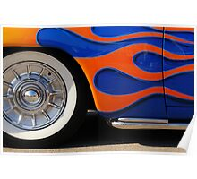 Chrome hubcap and orange flames Poster