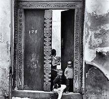 Three African kids Stonetown Zanzibar by Amyn Nasser