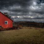 Red barn with storm clouds by woodnimages