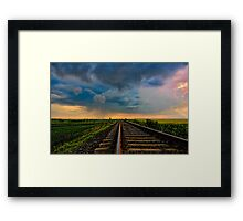 Village landscape with train tracks Framed Print