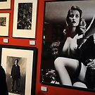 Unknown man looking at Art work of Helmut Newton worth $125.000 by Anton Oparin