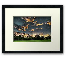 setting suns rays through the trees #1 Framed Print