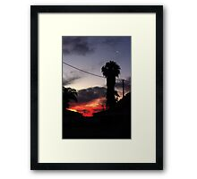 Cressent moon above sunset Framed Print