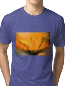 Extreme close up of a yellow daisy with a blue sky background  Tri-blend T-Shirt