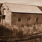 sepia effect on old farm building by gaylene
