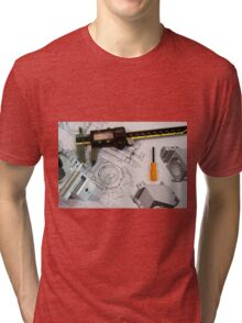 Metal tooling shop floor concept with CAD blueprint and micrometer calliper  Tri-blend T-Shirt